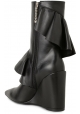 J.W. Anderson wedges midcalf boots in black leather