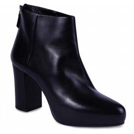 Prada Women's heeled ankle boots in black leather with back zip closure
